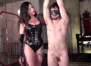 Tall Dominatrix Torments Marionette..