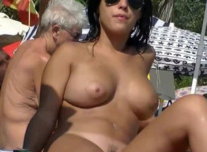 This nudist babes naked at the beach..